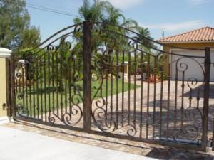 custom_fabricated_metal_swing_steel_scrollwork_entrance_estate_farm_ranch_driveway_gate_with_scrollwork_
