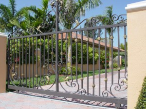 custom_fabricated_metal_swing_steel_scrollwork_entrance_estate_farm_ranch_driveway_gate_with_scrollwork_