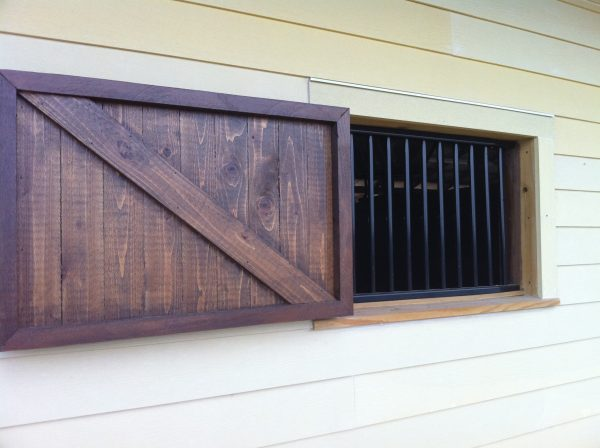 Custom Fabricated Metal Window Bars and Wooden Shutter